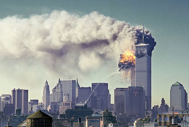 <i>:South Tower gets hit on 9-11, Image Source: <a href='https://commons.wikimedia.org/wiki/File:South_Tower_gets_hit_on_9-11.jpg'>Wikimedia Commons</a></i>