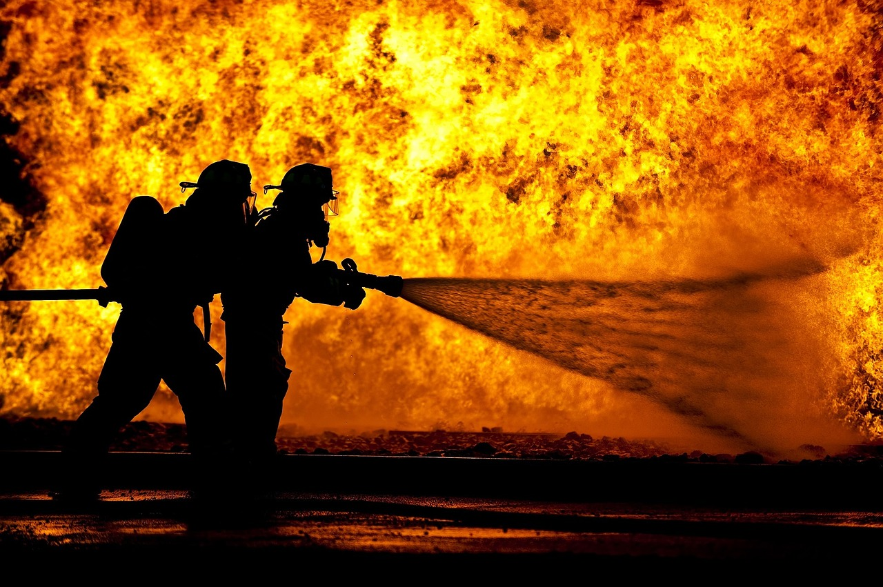 <i>Firefighters by <a href='https://pixabay.com/en/users/skeeze-272447/'>Skeeze</a> on <a href='https://pixabay.com/en/firefighters-training-live-fire-870888/'>Pixabay</a></i>